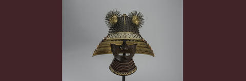 Rotating banner image: Samurai face guard and helmet, adorned with golden sea urchins